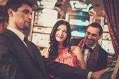 stock photo of slot-machine  - People near slot machine in a casino - JPG