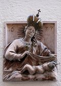 SALZBURG, AUSTRIA - DECEMBER 13, 2014: Virgin Mary with baby Jesus, statue on house facade Salzburg, Austria on December 13, 2014.