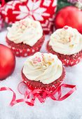 stock photo of red velvet cake  - Decorated red velvet cupcakes on holiday background