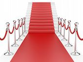 Staircase And Red Carpet Between Two Metallic Stanchions With Rope