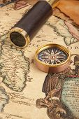 Vintage brass telescope on old antique map