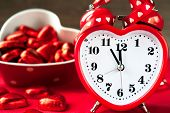 Love Heart Shape Red Clock And Sweet Chocolates. Time For Love.