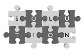 Parts of a puzzle connected together with letters spelling out the word solution