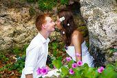 Happy Bride And Groom Having Fun On A Tropical Beach