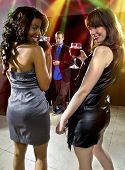 image of seducing  - women seducing a man at a bar or nightclub
