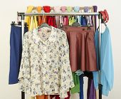 Cute Floral Outfits Displayed On A Rack.