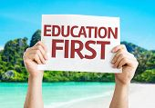 Education First card with a beach on background