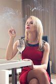 beautiful young woman drinking wine
