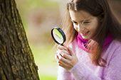 Child studing biology in nature