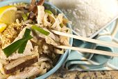 stock photo of gai  - Delicious Chicken Pad Thai with lemon and white rice - JPG