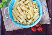 Cooked rigatoni pasta in a colander