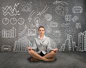 business woman meditating on floor