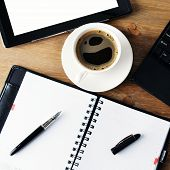 Notebook And Cup Of Coffee