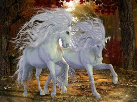 stock photo of colt  - Beautiful magical Unicorn stags prance on a forest road in the autumn season - JPG