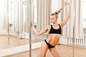 stock photo of pole dance  - Young Slim Pole Dance Blond Woman smile - JPG