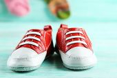 image of shoes colorful  - Colorful toddler shoes on wooden background - JPG