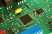 picture of processor  - Computer electronic green board circuit with processor - JPG