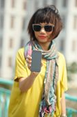 stock photo of foreground  - Young woman showing her smartphone focus on foreground - JPG