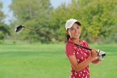 foto of ladies golf  - Beautiful young woman playing golf on the course - JPG