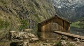 picture of dock a pond  - Boat dock hangar at Obersee Berchtesgaden Germany Bavaria - JPG