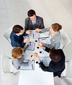 stock photo of helping others  - Above view of business people holding each other by hands - JPG