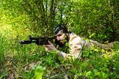pic of rifle  - Bearded soldier with a rifle in the woods - JPG