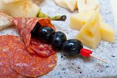 image of salami  - cold cut assortment cheese salami and fresh pears served on a granite stone - JPG