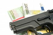 picture of gunshot  - gun and banknotes on white background closeup - JPG