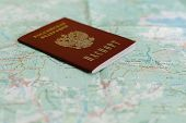 pic of passport cover  - an image of Russian passport on a the background of the tourist map - JPG
