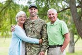 image of reunited  - Soldier reunited with his parents on a sunny day - JPG