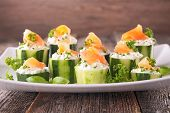 stock photo of canapes  - canape with cucumber - JPG