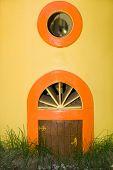 picture of windows doors  - The little door and window in a yellow wall  - JPG
