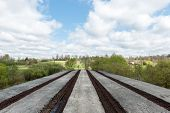 picture of old bridge  - old bridge with rusty metal rails near sea port - JPG