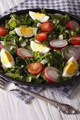 foto of sorrel  - Spring salad with eggs tomatoes radishes and sorrel close up on a plate - JPG