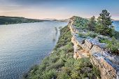 pic of horsetooth reservoir  - sandstone cliff and lake at dusk  - JPG