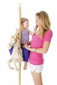 image of year horse  - An adorable 2 year old and her mom having fun with the carousel horse - JPG