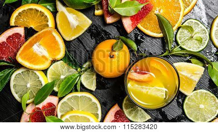 The Juice From Citrus Fruits - Grapefruit, Orange, Tangerine, Lemon, Lime In The Glass.