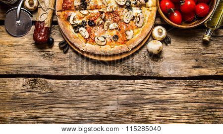 Italian Pizza And Different Ingredients - Meat, Mushrooms, Tomatoes And Olive Oil.