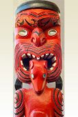 Maori Statue in Red and Black Paint