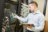 Networking service. network engineer administrator checking server hardware equipment of data center poster