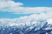 Mountains Under Snow In Bright Winter Day poster