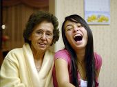Grandmother And Granddaughter Enjoy Each Other'S Company