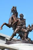 foto of civil war flags  - civil war statue at one of the corners of lincolns tomb springfield il with horse and soldier - JPG