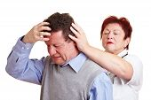 Man With Migraine Seeing A Doctor