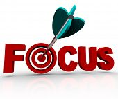 An arrow makes a direct hit in the bulls-eye target in the word Focus, illustrating the importance o