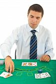 Man Playing Blackjack At Casino