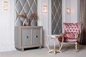 Luxury Interior. Luxurious Pink Velvet Armchair, Antique Carved Furniture, Classic Interior. poster