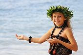 stock photo of hula dancer  - A young hawaiian dancer displays hand movements used in the traditional hula dance - JPG