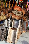 Mexican traditional handcrafts basketry and wood carts and  pinatas