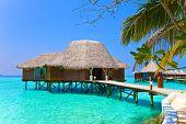 Island in ocean overwater villa.Maldives.